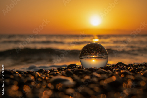 Fotografia Close-up Of Stones On Beach During Sunset