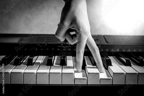 Fototapety, obrazy: musician's fingers on piano keys, blues and jazz, learning to play a musical instrument, black and white shot