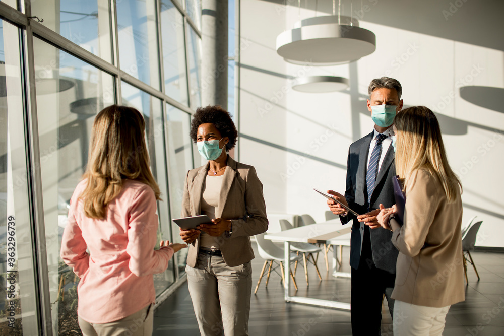 Fototapeta Group of multiethnic business people have a meeting and working in office while wear mask as protection from corona virus
