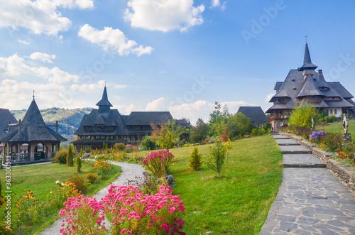 Traditional Maramures wooden architecture of Barsana monastery, Romania Fototapet