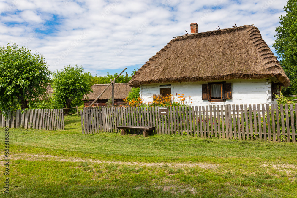 Fototapeta Traditional village in Poland. Open Air Museum. Wooden houses. Wooden folk architecture from different areas of the Lublin Voivodeship. Poland