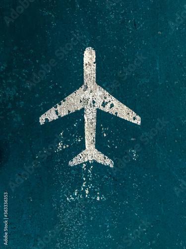 Flugzeug Icon auf petrolblauem Boden, Bodenmarkierung, hinweisschild urlaub Canvas Print