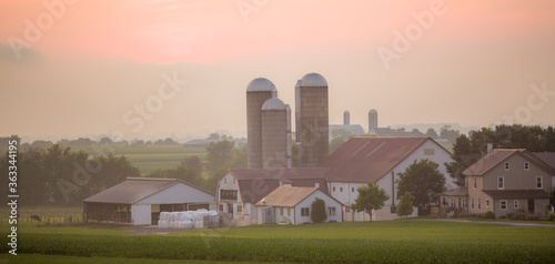 Amish farm in fog with barn and silos, near Intercourse, Pennsylvania, at sunset Fototapeta