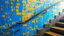 Retro Exit From The Underpass Of A Staircase With A Railing Against The Background Of A Blue Yellow Shabby Wall