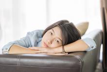 Portrait Of Teenage Girl Lying...