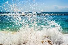 Water Splashing In Sea Against Sky