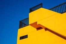 Low Angle View Of Yellow Building Against Sky