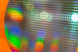 detail of a silicon wafer reflecting different colors.