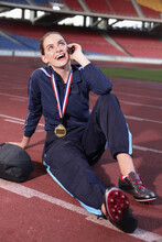 Female Athlete Talking On The Mobile Phone