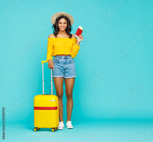 Stylish ethnic traveler with suitcase. Canvas