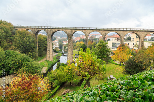 Obraz Arch Bridge Amidst Trees Against Sky - fototapety do salonu