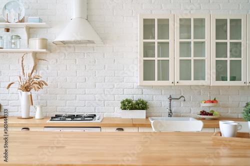 Fototapeta Kitchen wooden table top and kitchen blur background interior style scandinavian obraz