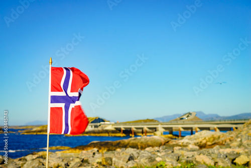 Norwegian flag against Atlantic Road, Norway Fotobehang