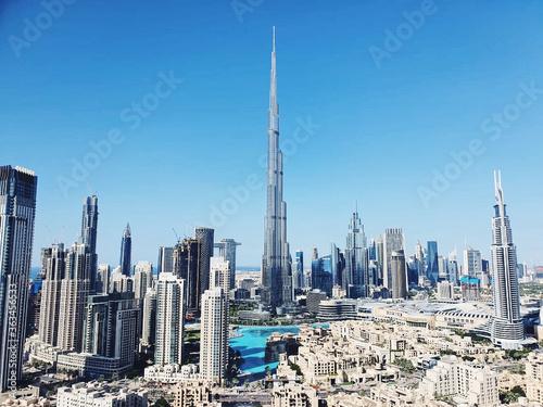 Fotografie, Tablou Panoramic View Of Dubai Tallest Building Burj Khalifa In Dubai City Against Blue