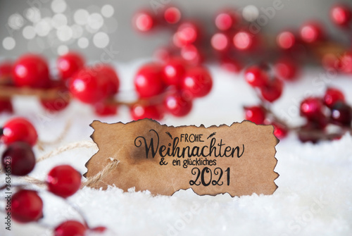 Fototapeta Burnt Label With German Calligraphy Frohe Weihnachten Und Ein Glueckliches 2021 Means Merry Christmas And A Happy 2021. Red Christmas Decoration With Snow obraz