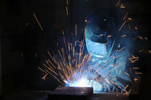 The Welder At The Factory Is E...