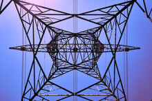 Power Line Metal Pylon With High Voltage Cables Bottom Up View