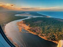 Aerial View Of Sea Seen Through Airplane Window