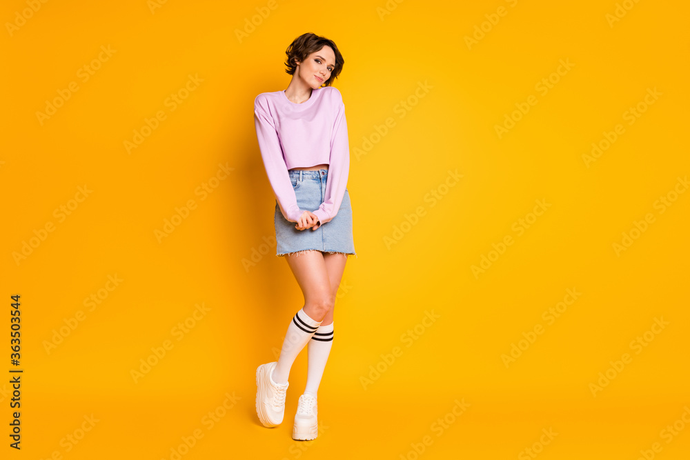Fototapeta Full length body size view of her she nice-looking attractive lovely charming shy slender cheery girl wearing teen look posing isolated on bright vivid shine vibrant yellow color background