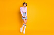 Full length body size view of her she nice-looking attractive lovely charming shy slender cheery girl wearing teen look posing isolated on bright vivid shine vibrant yellow color background