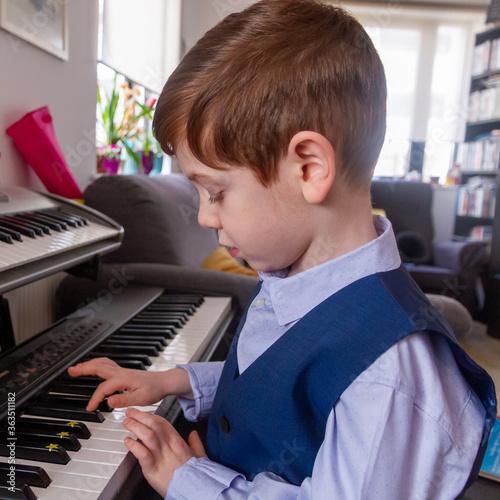 Photo Boy Playing Piano At Home
