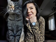 Beautiful Woman With Cat Looking Away