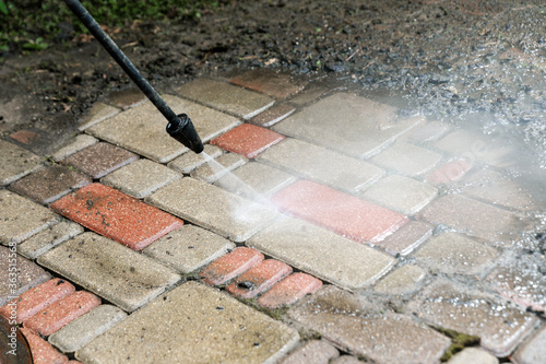 washing services - block paving cleaning with high pressure washer Canvas Print