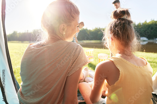 Fotografie, Obraz Mother and daughter spending time on camping
