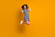 canvas print picture - Full length photo of crazy curly lady jump high raise fists celebrate amazing victory sportive competitions wear white casual striped short dress shoes isolated yellow color background
