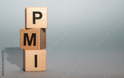 Photo PMI acronym word from wooden blocks with letters, abbreviation PMI Private Mortg