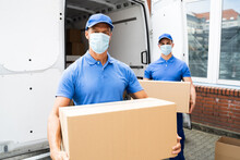 Blue Delivery Men Unloading Pa...