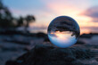 Close-up Of Crystal Ball On Rock Against Sky During Sunset