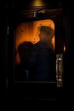 Silhouettes Though Pub Door