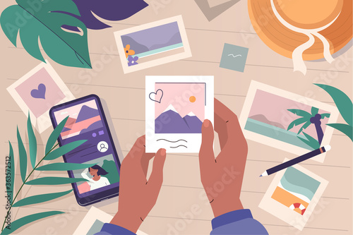 Fototapeta Photos Lying on Desk. Character Hands Holding Pictures and Remembering Memories form Travel. Smartphone with Social Media Lying near. Summer Vacation Concept. Flat Cartoon Vector  Illustration. obraz
