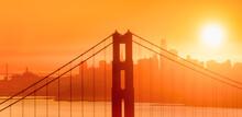 Golden Hour Sunrise Behind San Francisco Skyline And Golden Gate Bridge