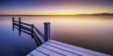Pier On Lake Against Sky Durin...