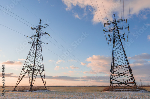 Power lines during a beautiful winter sunset. Canvas Print