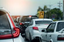ฺBrake Cars On Asphalt Roads During Rush Hours For Travel Or Business Work. With Blurred Of U-turn Sign Board.