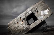 Face View Of A Concrete Bunker From Wwii On A French Beach