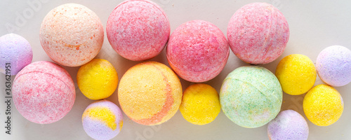 Leinwand Poster Multicolored bath bombs on a gray background top view, banner
