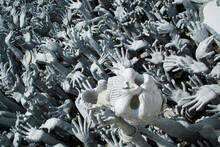 Sculptures Of Creepy Demon And Monster Heads At White Temple Wat Rong Khun In Thailand