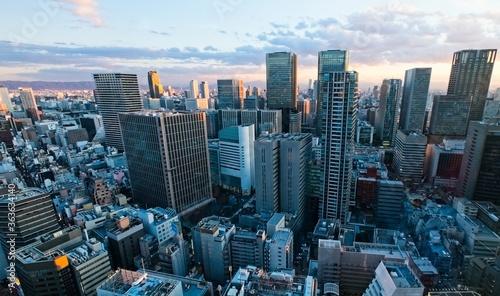 Foto Bird Aerial View Of Modern City High Rise Building Agaist The Sky