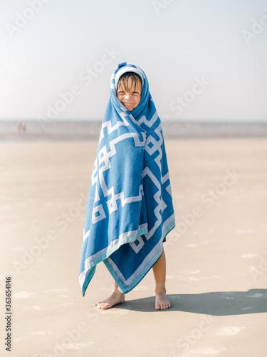 Cute boy in a towel at the beach - 363654146