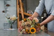 Female Florist Preparing Bouqu...