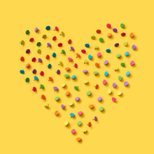 Heart Pattern Of Colored Office Pins On Yellow.