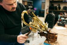 Band: Man Disassembles Trumpet...
