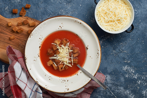 Fototapeta Tomato Soup with cheese and breadcrumbs obraz