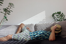 Relaxing On Couch At Home Whil...