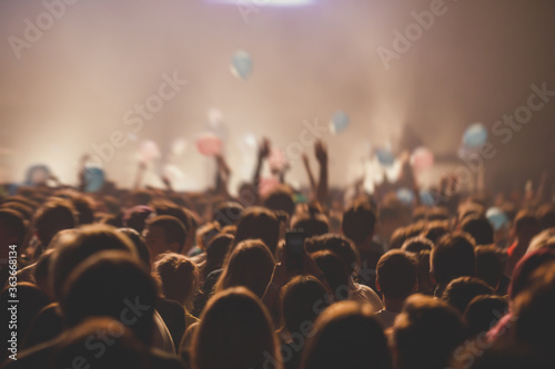 Papel de parede A crowded concert hall with scene stage lights, rock show performance, with peop