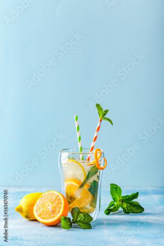 Fototapeta Refreshing cocktails with mint with lemon, orange, mint and ice obraz na płótnie